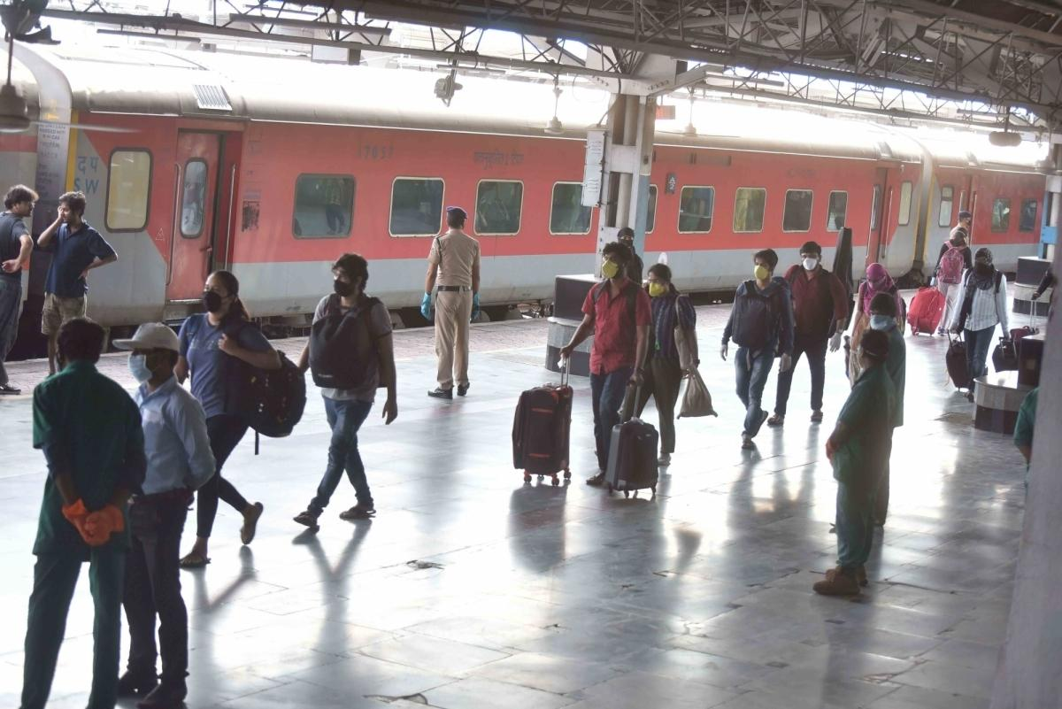 People stranded in Hyderabad due to the ongoing nationwide lockdown imposed to mitigate the spread of coronavirus, arrive at Secunderabad Junction railway station to board special trains being run by the Indian Railways to return to their respective nativ