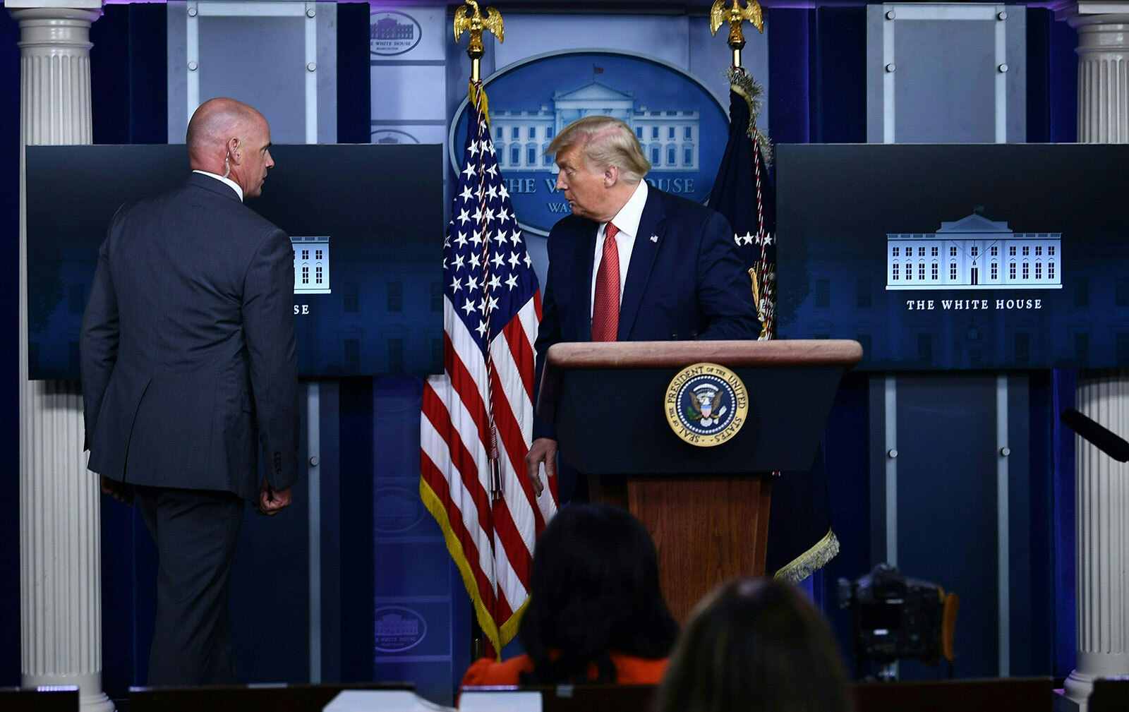 President Donald Trump is being removed from the Brady Briefing Room of the White House in Washington on Monday, August 10.